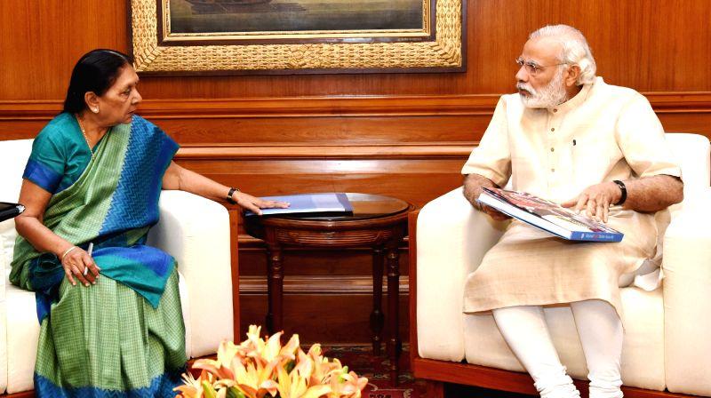 Gujarat Chief Minister Anandiben Patel calls on Prime Minister Narendra Modi in New Delhi, on May 16, 2016. - Anandiben Patel and Narendra Modi