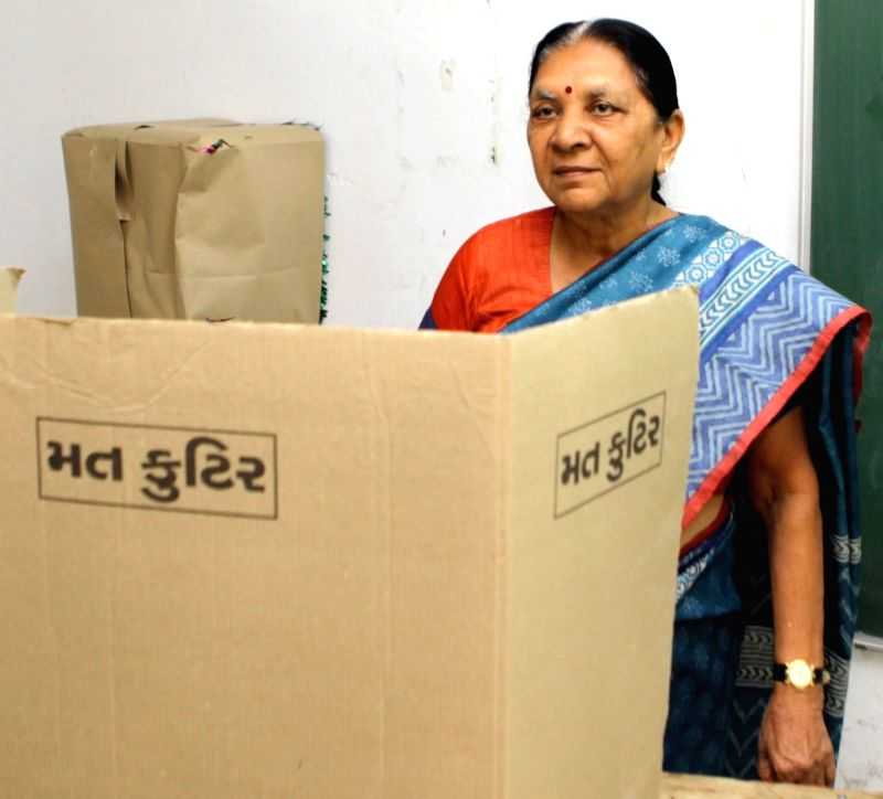 Gujarat Chief Minister Anandiben Patel casts her vote during the first phase of the two-phase local body elections in Ahmedabad, on Nov 22, 2015. - Anandiben Patel