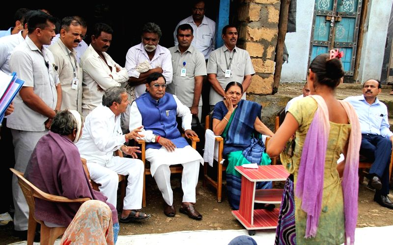 Gujarat Chief Minister Anandiben Patel meets the parents of Una's village victims at Samdhiyala village in Gujarat on July 20, 2016. - Anandiben Patel