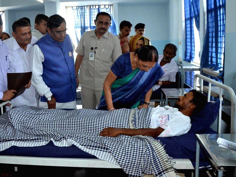 Gujarat Chief Minister Anandiben Patel visits victims of Una's village at Rajkot Civil hospital in Rajkot on July 20, 2016. - Anandiben Patel