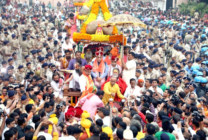 Gujarat Chief Minister Vijay Rupani and Deputy Chief Minister Nitinbhai Patel participate in the traditional 141st Rath Yatra of Lord Jagannath, in Gujarat's Jamalpur on July 14, 2018. - Vijay Rupani and Nitinbhai Patel