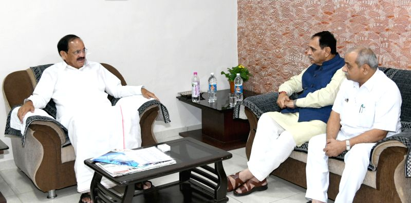 Gujarat Chief Minister Vijay Rupani and Deputy Chief Minister Nitinbhai Patel call on Vice President M. Venkaiah Naidu in Bhavnagar, Gujarat on August 12, 2018. - Vijay Rupani, M. Venkaiah Naidu and Nitinbhai Patel