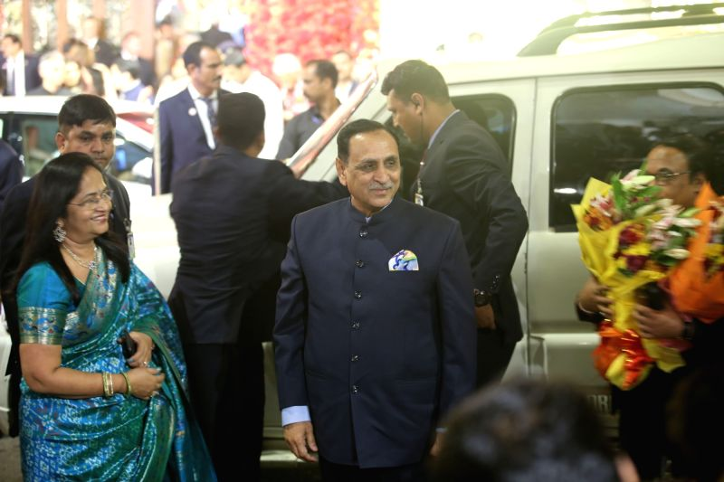 Gujarat Chief Minister Vijay Rupani at the wedding ceremony of industrialist Mukesh Ambani's daughter Isha Ambani and Anand Piramal at Antilia in Mumbai on Dec 12, 2018. - Vijay Rupani, Mukesh Ambani and Isha Ambani