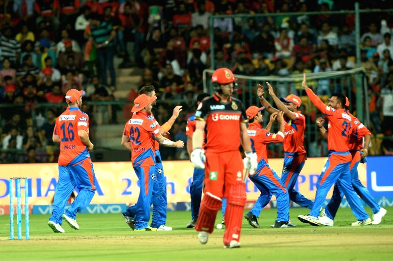 Gujarat Lions celebrate fall of a wicket during an IPL 2017 match between Gujarat Lions and Royal Challengers Bangalore at M Chinnaswamy Stadium in Bengaluru on April 27, 2017.