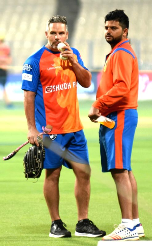Gujarat Lions coach Brad Hodge and skipper Suresh Raina during a practice session in Kolkata on April 20, 2017.