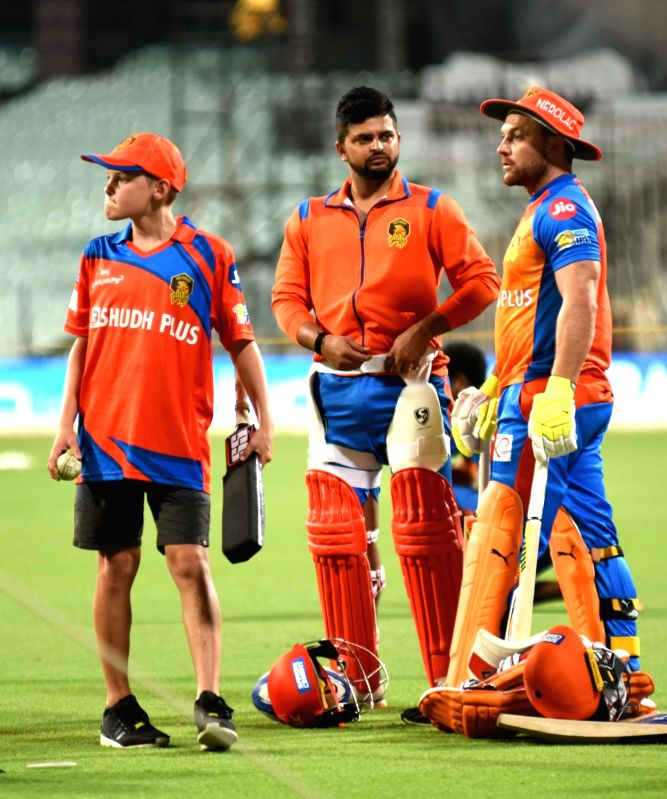 Gujarat Lions skipper Suresh Raina and Brendon McCullum during a practice session in Kolkata on April 20, 2017.