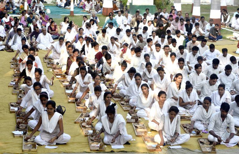 Gujarat Vidhyapeath students spinning Charkha to mark the death anniversary of Mahatma Gandhi at Kochrab Ashram in Ahmedabad on Jan 30, 2018.