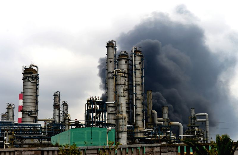 Photo taken on April 8, 2015 shows the heavy smoke of a burning chemical plant in Zhangzhou, southeast China's Fujian Province. A fire at the chemical plant that ...