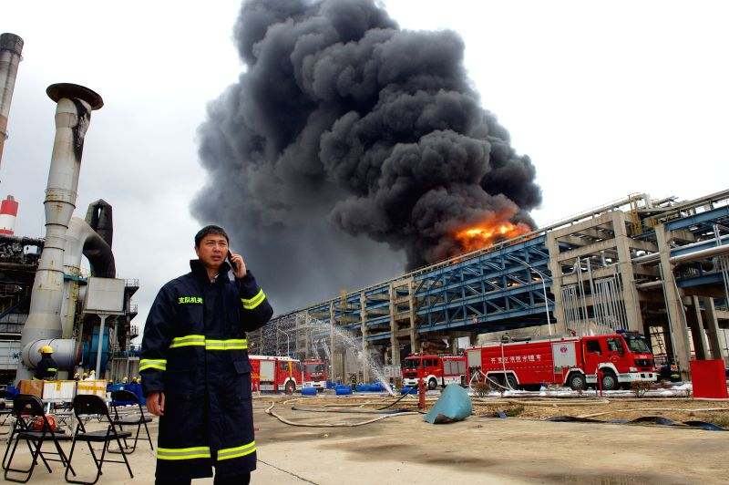 Photo taken on April 8, 2015 shows a burning chemical plant in Zhangzhou, southeast China's Fujian Province. A fire at the chemical plant that exploded on April 6 in ...