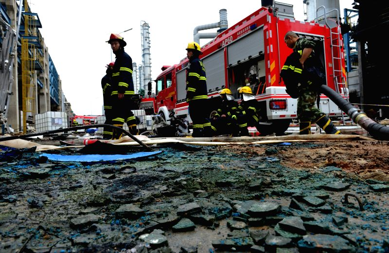 Firefighters prepare to leave the site of a fire in a plant of Tenglong Aromatic Hydrocarbon (Zhangzhou) Co. Ltd. on Gulei Peninsula of Zhangzhou City, southeast ...