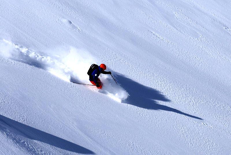 A skier enjoys skiing in Gulmarg on Jan 23, 2015.