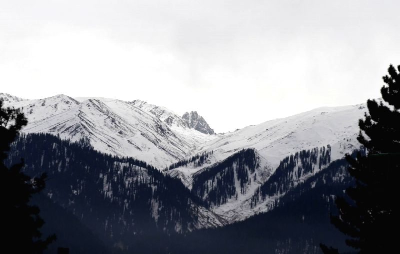 A view of a snow clad mountains from Gulmarg in Jammu and Kashmir on Dec 21, 2014.