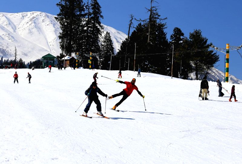 Tourists enjoy themselves at a ski resort in Gulmarg, Jammu and Kashmir on Feb 12, 2015.