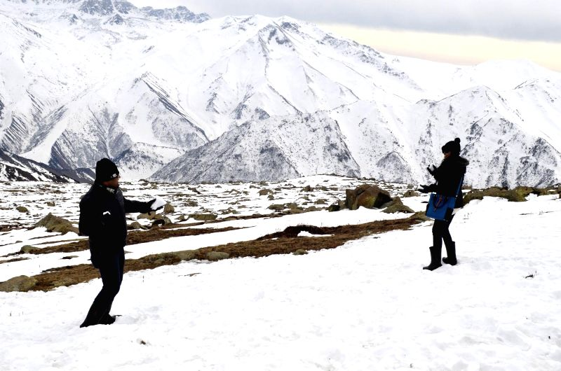 Tourists enjoy themselves in snow covered Gulmarg, Jammu and Kashmir.