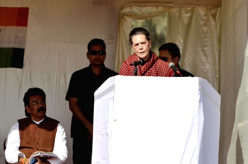 Congress chief Sonia Gandhi addresses a rally in Gumla district of Jharkhand ahead of assembly polls in the state on Nov 23, 2014.