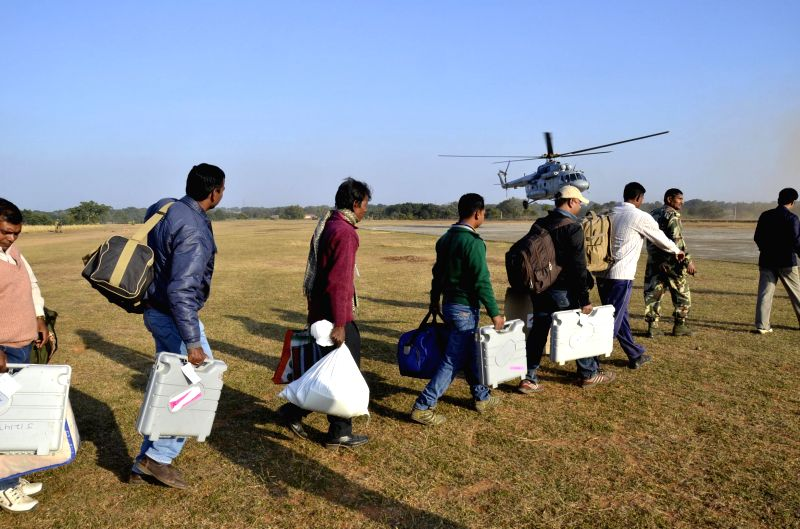 Polling personnel deployed in the Maoist infested areas of Jharkhand queue-up to board an Air Force helicopter ahead of the first phase of assembly elections in Gumla, Jharkhand on Nov 23, ...