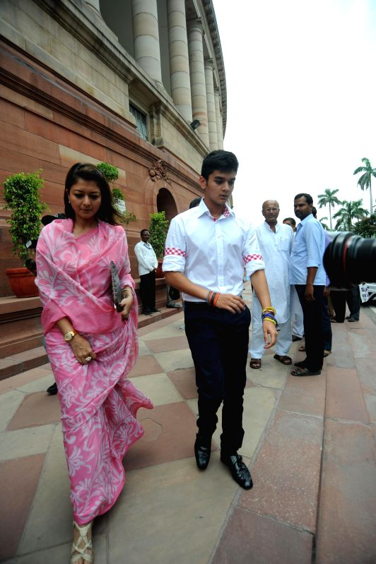 Guna MP and Congress leader Jyotiraditya Madhavrao Scindia's wife and son during their visit to the Parliament in New Delhi on July 16, 2014.