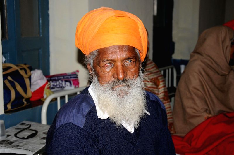 A man who lost his vision after undergoing eye surgery at an eye camp organised by an NGO in Gurdaspur district of Punjab  on Dec 5, 2014. At least 15 people lost their vission after ...