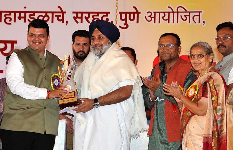 Punjab Deputy Chief Minister Sukhbir Singh Badal with Maharashtra Chief Minister Devendra Fadnavis  during the Akhil Bhartiya Marathi Sahitya Samelan in Ghuman near Gurdaspur of Punjab on ... - Sukhbir Singh Badal