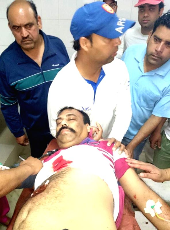 Shiv Sena (Bal Thackeray) state secretary Harvinder Soni being taken for treatment after he was shot at by an unidentified assailant in Punjab's Gurdaspur town on April 12, 2015.