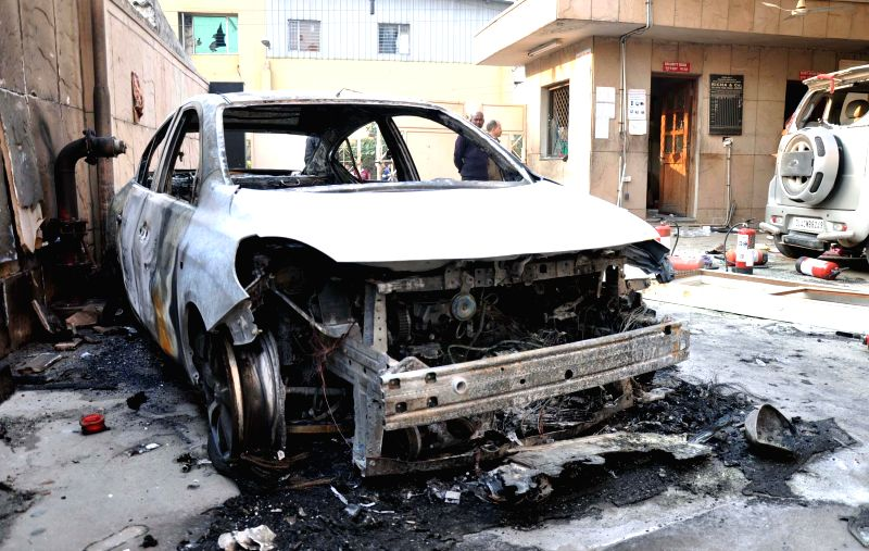 A car that was vandalised by a mob  -  mostly comprising factory workers - over rumours that a worker had died in the clash with factory officials in Gurgaon on Feb 12, 2015.