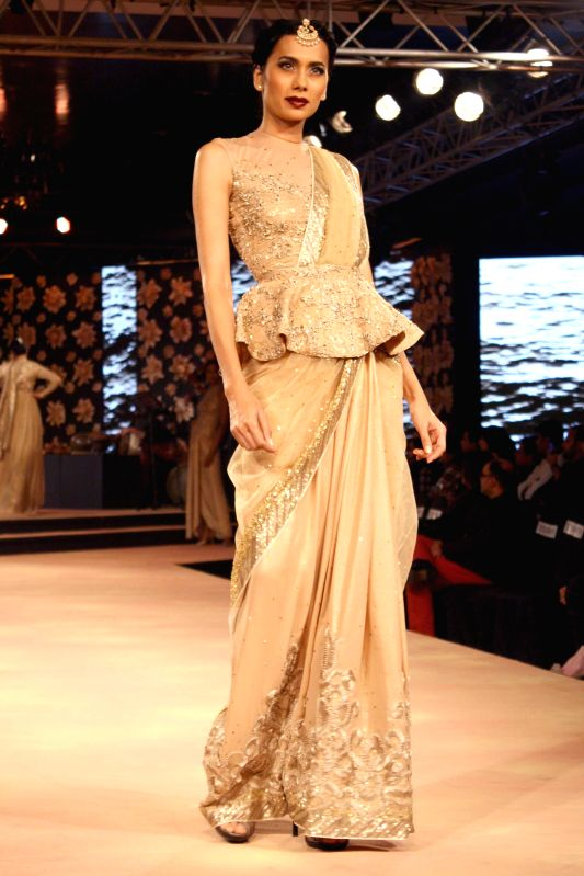 A model showcases fashion designer Neeta Lulla's creations at the Blenders Pride Fashion Tour 2014, in Gurgaon, on Nov 23, 2014.