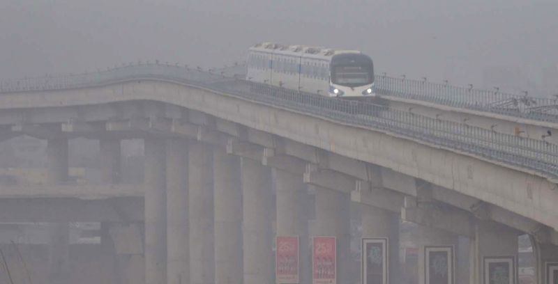 A Rapid Metro rake plies on a foggy day in Gurgaon on Jan 12, 2015.