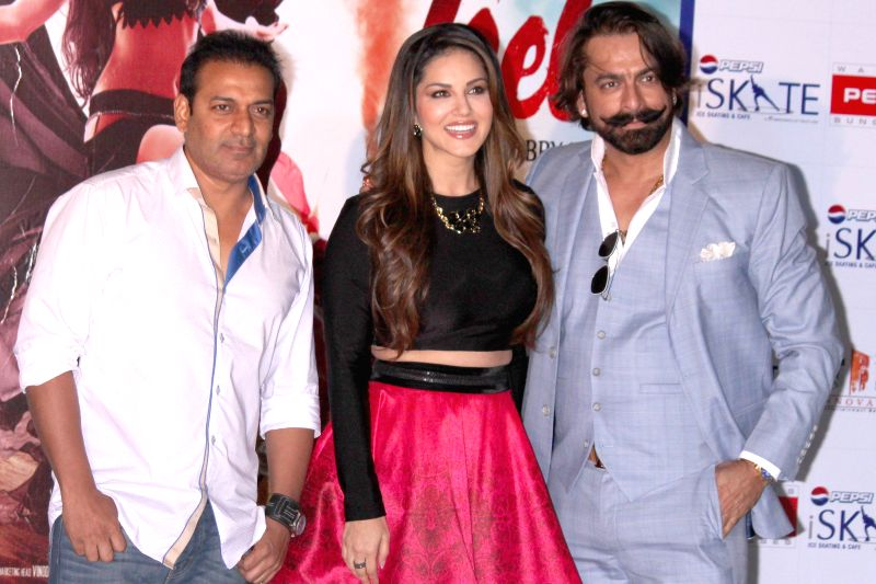 Actors Sunny Leone, Jas Arora with filmmaker Bobby Khan during the promotion of film `Ek Paheli Leela`, in Gurgaon on April 7,2015.