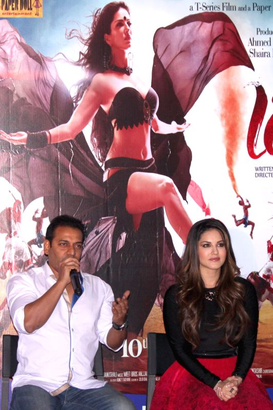 Actress Sunny Leone and filmmaker Bobby Khan during the promotion of film `Ek Paheli Leela`, in Gurgaon on April 7,2015.