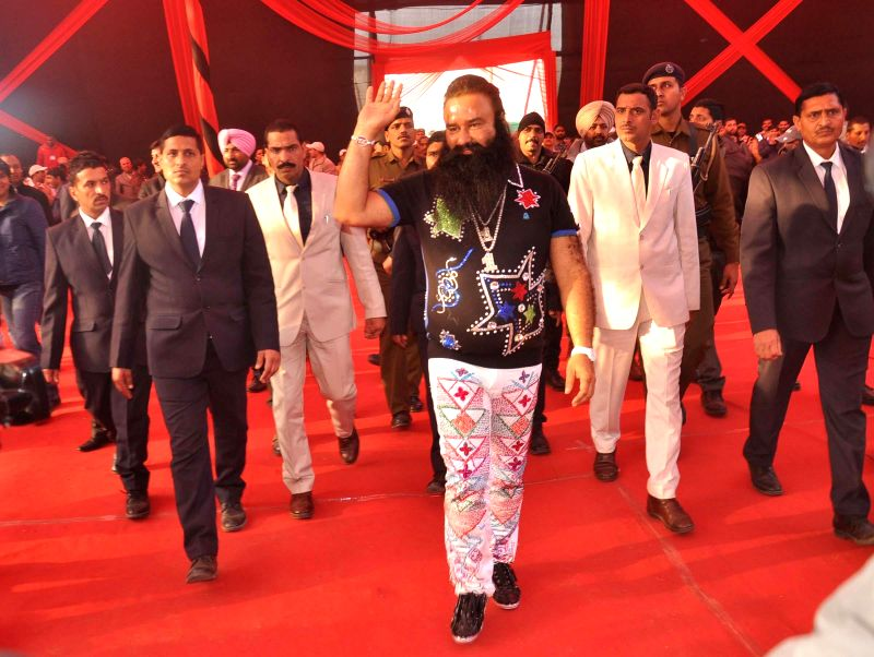 Dera Saccha Sauda chief Gurmeet Ram Rahim Singh arrive at the premiere of his film `MSG - The Messenger of God` in Gurgaon on Jan 16, 2015.