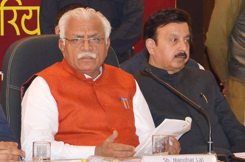 Haryana Chief Minister Manohar Lal Khattar addresses a press conference in Gurgaon on Feb. 4, 2015. Also seen PWD (B&R) minister Rao Narbir Singh. - Manohar Lal Khattar and Rao Narbir Singh