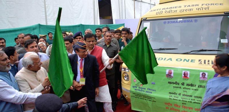 Haryana Chief Minister Manohar Lal Khattar flags off a mobile van at the launch of an anti-rabies programme in Gurgaon on March 13, 2015. Also seen Haryana Agriculture Minister Om Prakash ... - Manohar Lal Khattar