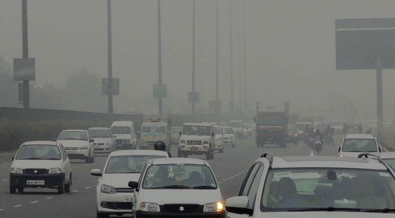 Heavy fog occurred due to chilly weather at NH-8 in Gurgaon on Dec. 13, 2014.