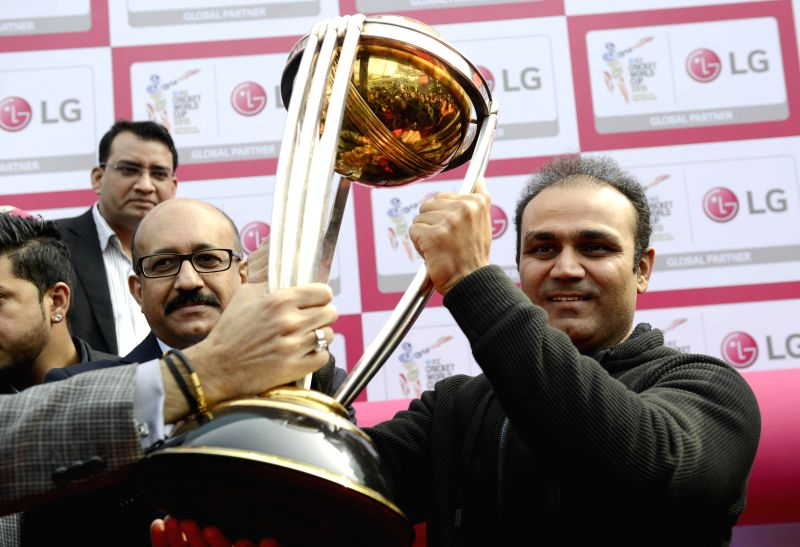 Hyderabad: Indian cricketer Virender Sehwag with the ICC World Cup Trophy during a programme in Gurgaon, on Jan 9, 2015.