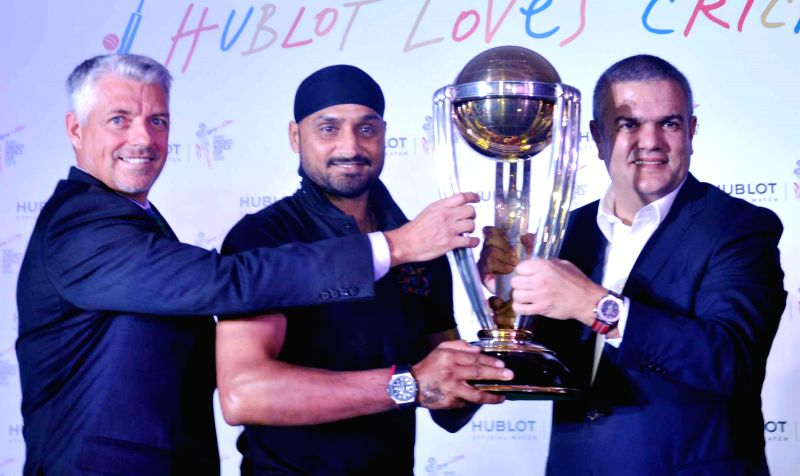Indian cricketer Harbhajan Singh with CEO Hublot SA Ricardo Guadalupe and ICC CEO Dave Richardson during a press conference in Gurgaon on Nov 24, 2014.