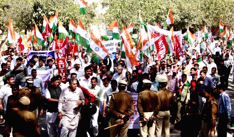 Members of various trade unions participate in a demonstration against the central government in Gurgaon, on Feb 26, 2015.