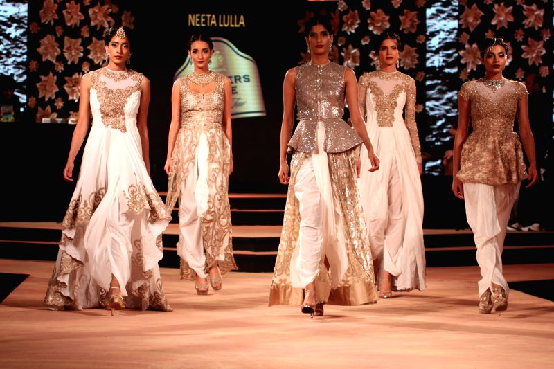 Model showcase fashion designer Neeta Lulla's creations at the Blenders Pride Fashion Tour 2014, in Gurgaon, on Nov 23, 2014.