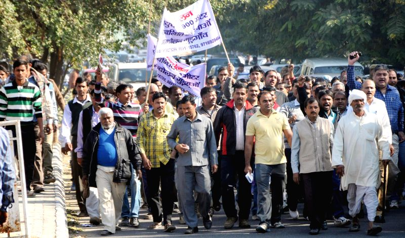 People residing near air force ammunition depot stage a protest to press for their demands in Gurgaon on Dec 8, 2014.