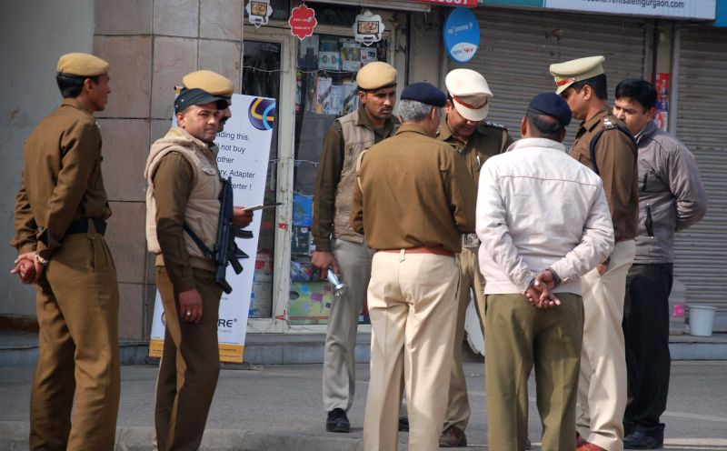 Policemen deployed outside Arcadia shopping complex in South City on Sohna road, Gurgaon after a bomb hoax call on Dec 18, 2014.
