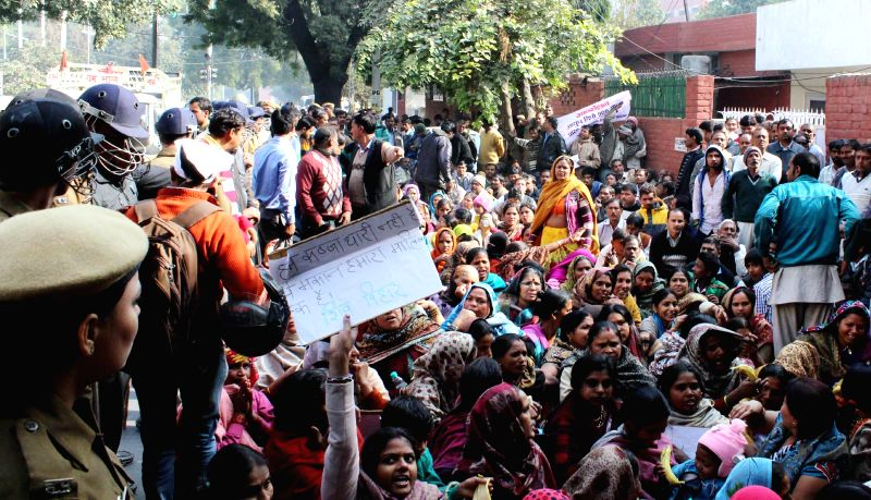 Residents living within the radius of Air Force ammunition depot stage a demonstration to press for their demands in Gurgaon on Dec 12, 2014.