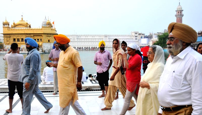 Gursharan Kaur, wife of former Prime Minister Manmohan Singh arrives to pay obeisance at Golden Temple in Amritsar on July 26, 2014.