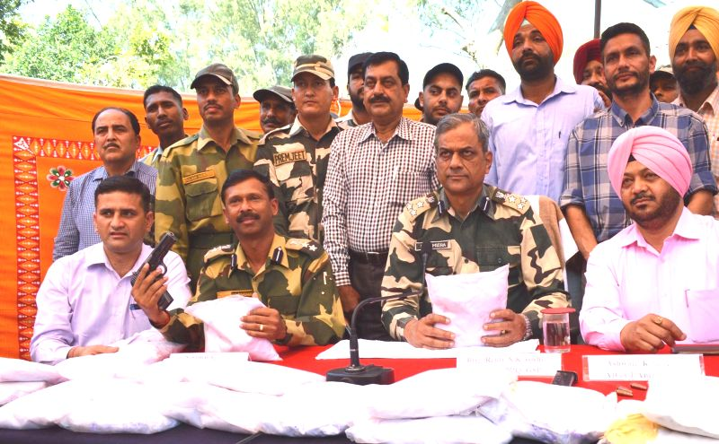 BSF officials display 18 kg heroin worth Rs 90 crore in the international market recovered by them in Gurudaspur on March 23, 2015.