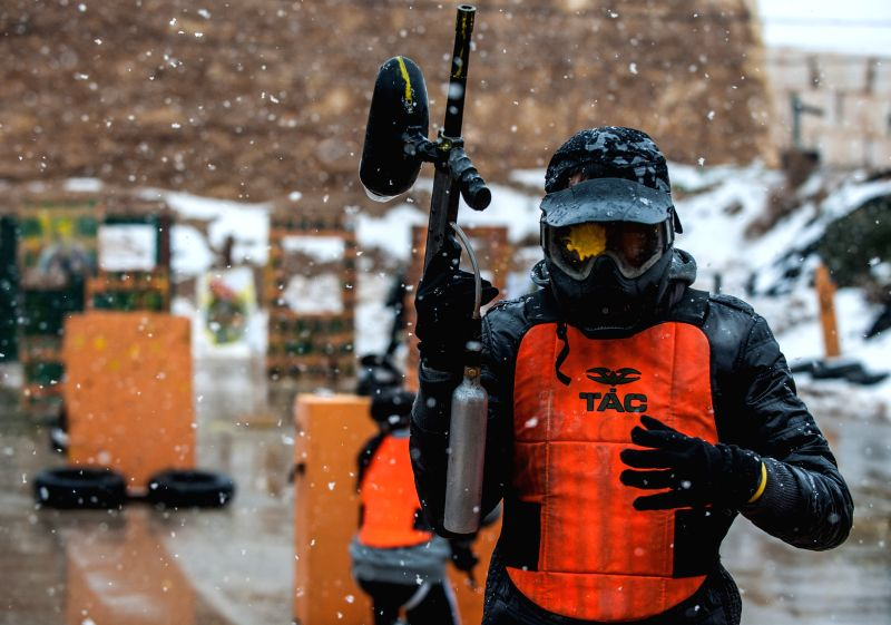 "A student leaves a paintball shooting after his goggle was shot during a military and counter-terror drill at ""Caliber 3"" Israeli Counter Terror and ..."