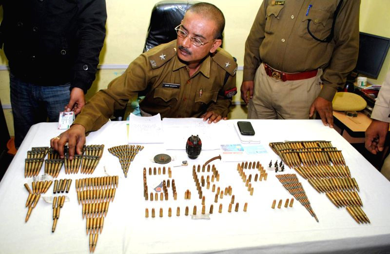 A police officer shows ammunition recovered from a Havildar of Meghalaya Police from Guwahati Railway Station on Jan 12, 2015.