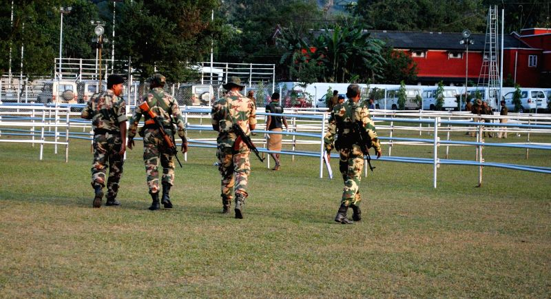 A soldier stands guard at NF Railway Stadium, Maligaon in Guwahati, on the eve of Prime Minister Narendra Modi's two-day visit to the city on Nov 28, 2014. - Narendra Modi