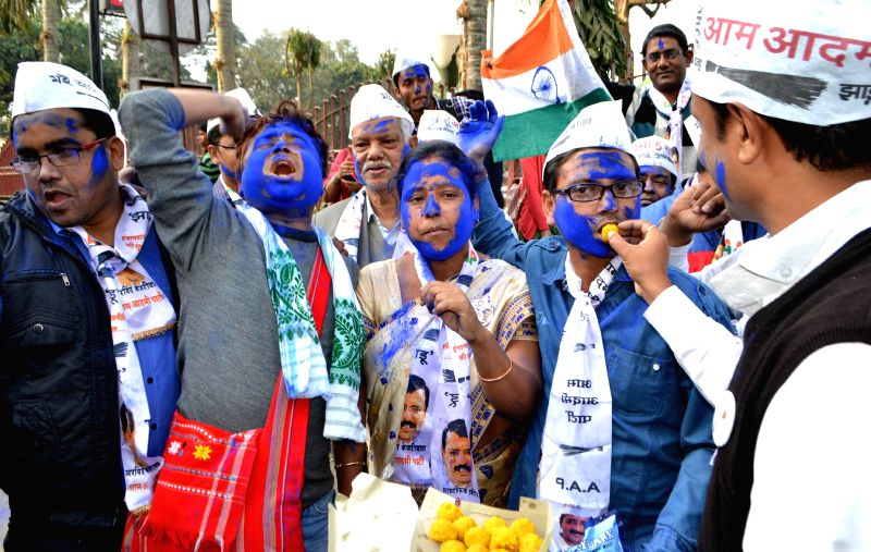 Aam Aadmi Party (AAP) workers celebrate party's victory in the recently concluded Delhi Assembly Polls in Guwahati, on Feb 10, 2015.