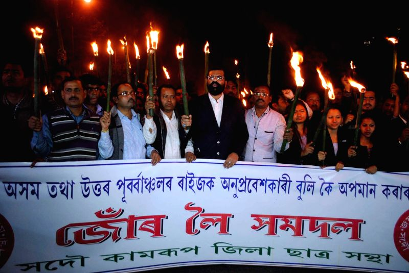 Activists of All Assam Student`s Union (AASU) taking out torch light procession against BJP`s vision document for the Delhi assembly polls. BJP's vision document referred people from ...