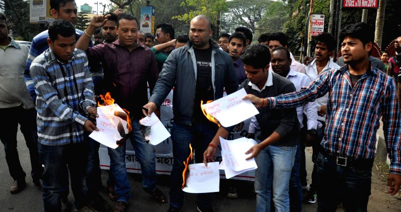 Activists of Asom Jatiyatabadi Yuva Chatra Parishad (AJYCP) burns BJP`s vision document for the Delhi assembly polls which mentioned the people from north eastern states living in the ...