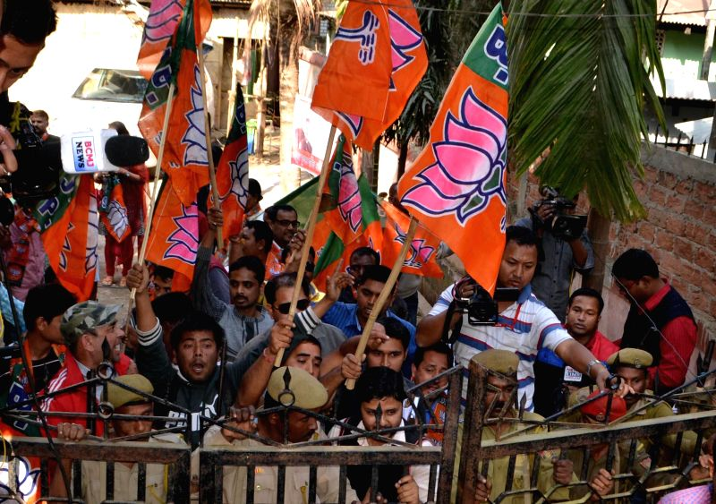 Activists of Bharatiya Janata Party (BJP) obstruct the members of National Students` Union of India (NSUI) while the student wing of the Indian National Congress party staging a ...