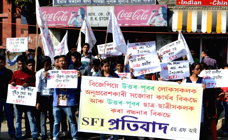 Activists of Students Federation of India (SFI) staging protest demonstration  protesting against BJP's vision document for the Delhi assembly polls which mentioned the people from north ...